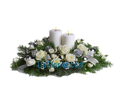 """A composition of roses, candles, fir branches, games"" in the online flower shop uaflorist.com"